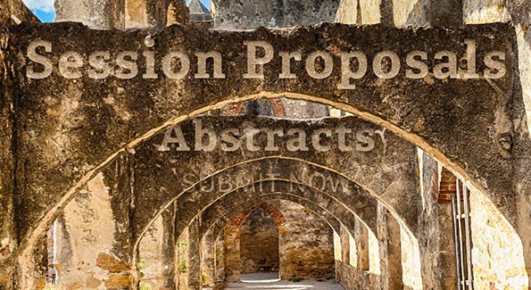 'session proposals' and 'abstracts' etched into Alamo walls